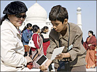 An unidentified woman and Tanay Chheda in a scene from Slumdog Millionaire
